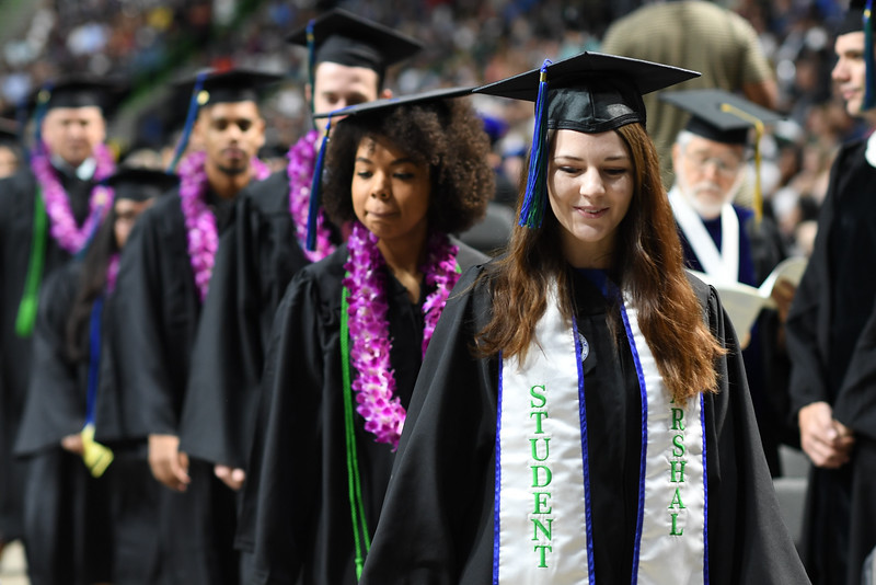 Texas A&M University-Corpus Christi graduates enter the American Bank Center arena before the spring 2019 commissioning ceremonies.