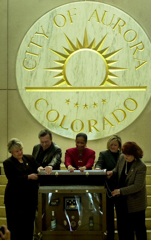 . FROM LEFT TO RIGHT- Barbara Cleland, Mayor Paul Tauer, Edna Mosley, Kathy Green, and Nadine Caldwell  take part in closing the Time Capsule vault during the City of Aurora\'s Time Capsule Celebration at the Municipal Justice Center. The Time Capsule will remain as a visual display and displayed in different locations around the city. The time capsule will find a permanent home in the new City of Aurora Municipal Building and will be re-opened in 2050. (Photo by John Leyba/The Denver Post)