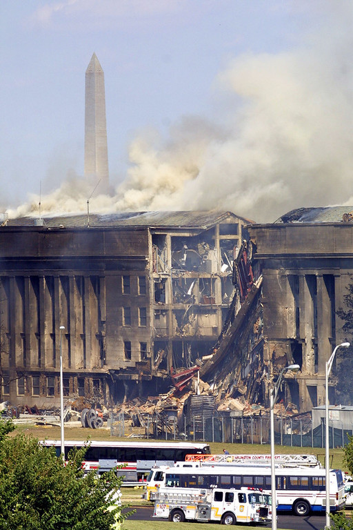 . Smoke comes out from the Southwest E-ring of the Pentagon building September 11, 2001 in Arlington, Va., after a plane crashed into the building and set off a huge explosion. (Photo by Alex Wong/Getty Images)