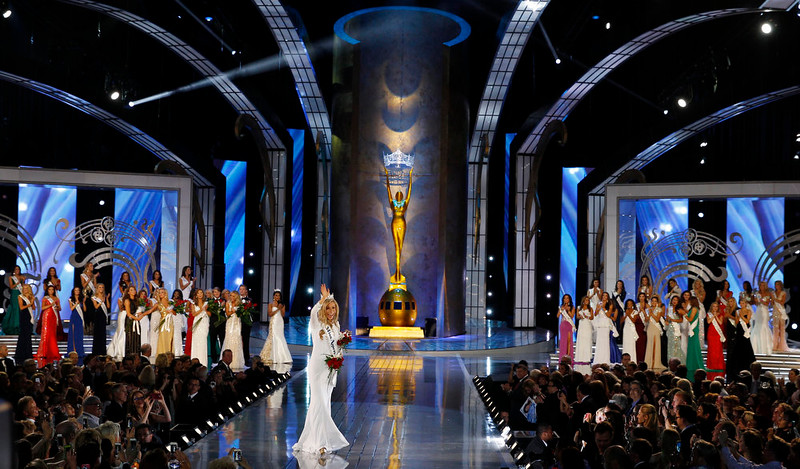 . Miss New York Kira Kazantsev, center, walks the runway after being crowned Miss America 2015 during the Miss America 2015 pageant, Sunday, Sept. 14, 2014, in Atlantic City, N.J. (AP Photo/Mel Evans)