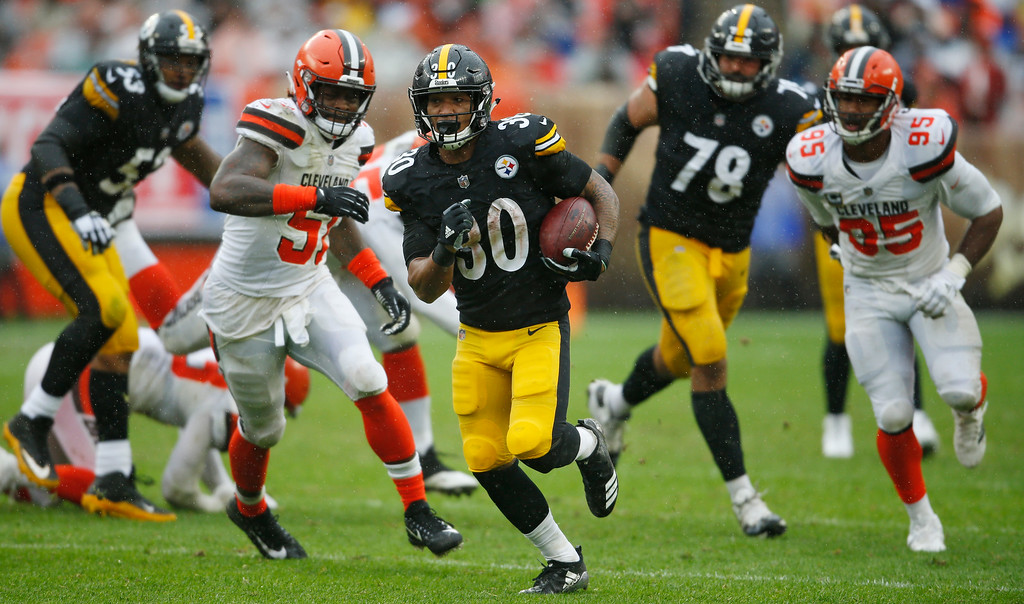 . Pittsburgh Steelers running back James Conner (30) rushes during the second half of an NFL football game against the Cleveland Browns, Sunday, Sept. 9, 2018, in Cleveland. (AP Photo/Ron Schwane)