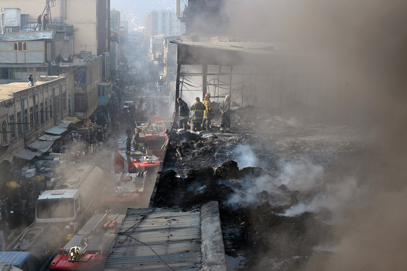 . Afghan firefighters are pictured at the scene after a huge fire swept through a market in Kabul on  December 23, 2012.  A huge fire swept through a market in downtown Kabul on December 23, destroying hundreds of shops and forcing the city\'s nearby money exchange to evacuate, police and witnesses said. There were no reports of any casualties in the early morning blaze which destroyed most of the cloth market\'s 500 shops, Kabul fire department officials told AFP. SHAH MARAI/AFP/Getty Images