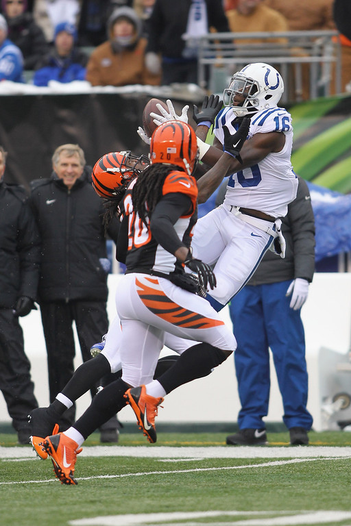 . Da\'Rick Rogers #16 of the Indianapolis Colts goes up for the pass against the pressure of Adam Jones #24 of the Cincinnati Bengals during their game at Paul Brown Stadium on December 8, 2013 in Cincinnati, Ohio.  (Photo by John Grieshop/Getty Images)