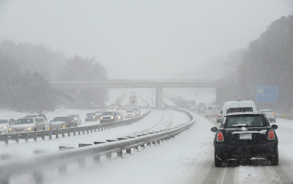 . Traffic on Durham Freeway 147 creeps along as compacted snow turns into ice on February 12, 2014 in Durham, North Carolina. Snow fell hard and fast in central North Carolina, resulting in abandoned cars and vehicular accidents by mid-afternoon. (Photo by Sara D. Davis/Getty Images)because