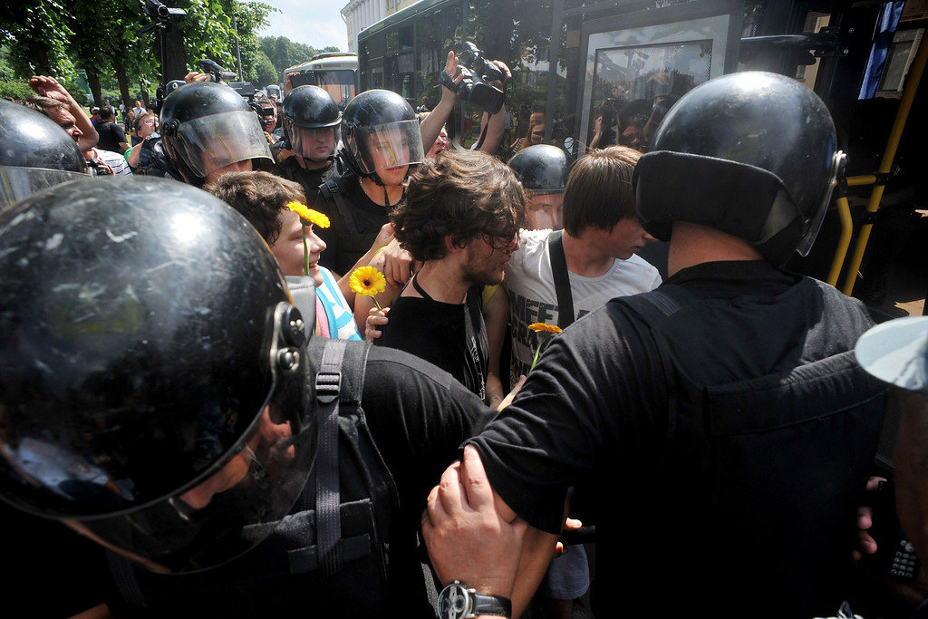 . Russian riot police detain gay rights activists during a gay pride event in St. Petersburg on June 29, 2013. Russian police arrested dozens of people on Saturday after clashes erupted in the city of Saint Petersburg between pro- and anti-gay demonstrators. OLGA MALTSEVA/AFP/Getty Images