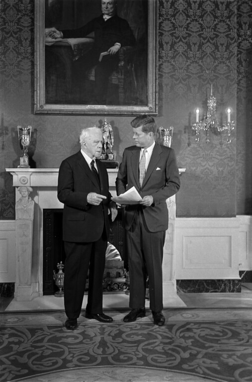 . President John F. Kennedy and poet Robert Frost chat in the green room of the White House under a portrait of John Quincy Adams.  The 85-year-old poet who delivered one of his own works at Kennedy\'s inauguration, was the first scheduled visitor on Sunday, January 22, 1961 to the White House.  (AP Photo)