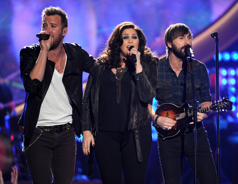 . From left, Charles Kelley, Hillary Scott and Dave Haywood, of the musical group Lady Antebellum, perform at the American Country Awards at the Mandalay Bay Resort & Casino on Tuesday, Dec. 10, 2013, in Las Vegas, Nev. (Photo by Frank Micelotta/Invision/AP)