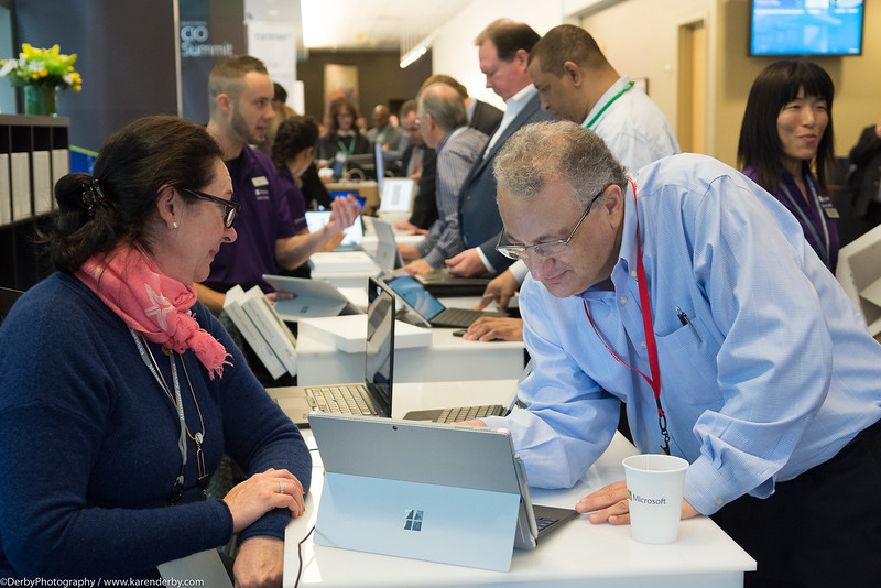 A CIO Summit attendee enjoys learning about his new Microsoft Surface from technical support at the Enterprise and Partners Group Summit.