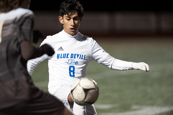 11/14/18 Wesley Bunnell | Staff Plainville #23 vs Stonington #3 soccer in the Class M Semifinal at Xavier High School on Wednesday night. Michael Torres (8).