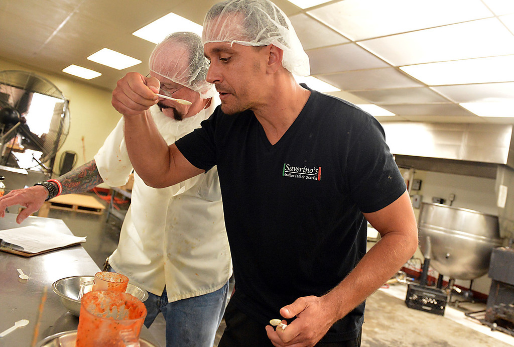 . David Saverino gets the first taste of his sauce Thursday May 8, 2014 before beginning the bottling process. Following the successful launch of Saverino\'s Italian Deli and Market in Redlands nearly two years ago, David Saverino is bottling the flavor of his business with the introduction of four separate sauces. In addition to selling the sauces at his deli, Saverino hopes to see his product on the shelves of local markets. (Photo by Rick Sforza/Redlands Daily Facts)