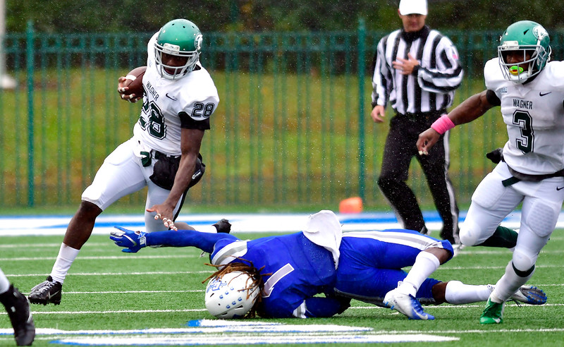 10/27/2018 Mike Orazzi   Staff CCSU's DJ Exilhomme (1) and Wagner's  Denzel Knight (28) during Saturday's football game in New Britain with Wagner.