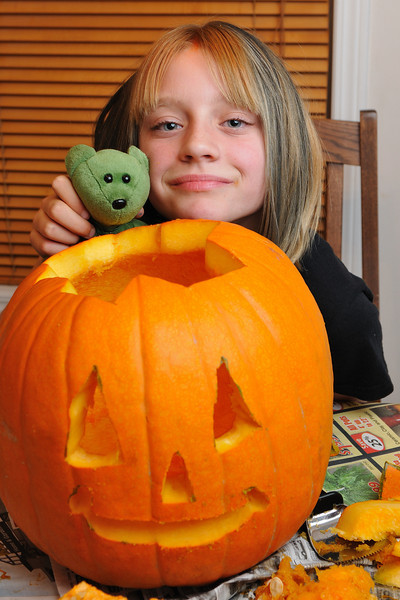 Clare and her stuffy - Legolas - pose with her pumpkin