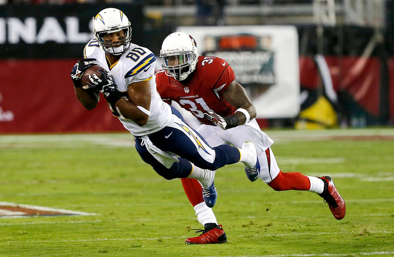 . San Diego Chargers wide receiver Malcom Floyd (80) pulls in a pass as Arizona Cardinals cornerback Antonio Cromartie (31) defends during the first half of an NFL football game, Monday, Sept. 8, 2014, in Glendale, Ariz. (AP Photo/Rick Scuteri)