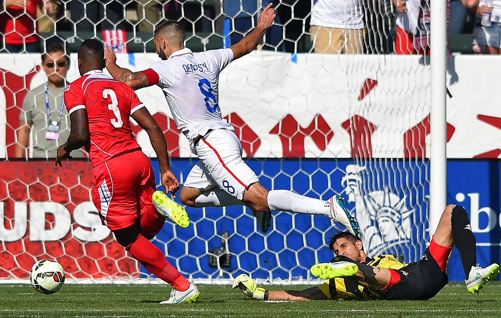 . USA�s Clint Dempsey scores past Panama goalie Jaime Penedo at the StubHub Center in Carson, CA on Sunday, February 8, 2015. US men\'s national team vs Panama in an international friendly soccer match. 1st half. (Photo by Scott Varley, Daily Breeze)