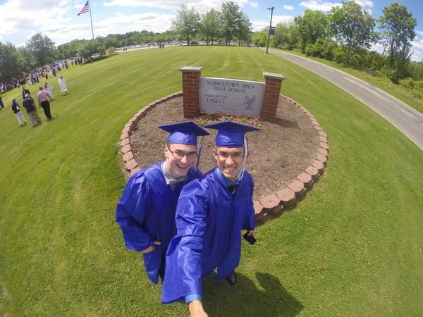 Description of . @sk8rkoby takes a selfie at Norristown Area High School's graduation.