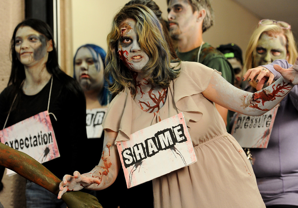 . BOULDER, CO- FEBRUARY 19:  Phillipa Keosheyan, 14, and other Zombies walk the halls during the shooting of the video at Fairview High School in Boulder on February 19th, 2013.  With the help of a professional videographer, Fairview High School students produced a zombie video to advertise an Awareness Drive in Boulder Valley schools designed to bring attention to a variety of mental health and wellness issues.  Students were made to look like zombies by make-up artists from Theatrical Costumes, Etc. (Photo By Helen H. Richardson/ The Denver Post)