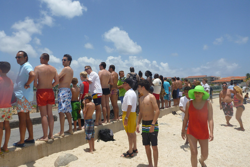 People waiting to be blown over by the jets at Maho Beach.