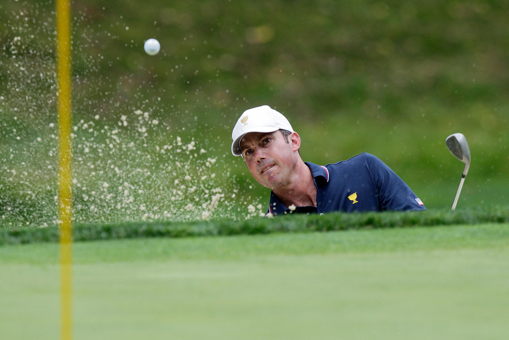. United States team player  Matt Kuchar plays from the sand on the second hole during the four-ball match at the Presidents Cup golf tournament at Muirfield Village Golf Club Thursday, Oct. 3, 2013, in Dublin, Ohio. (AP Photo/Jay LaPrete)