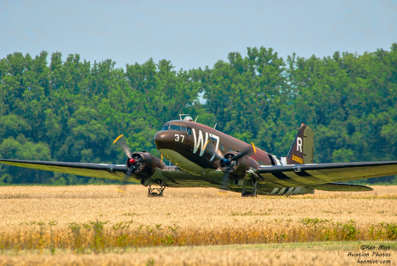 Whiskey 7 the C-47 of the National Warplane Museum on the grass strip at Geneseo Airshow.