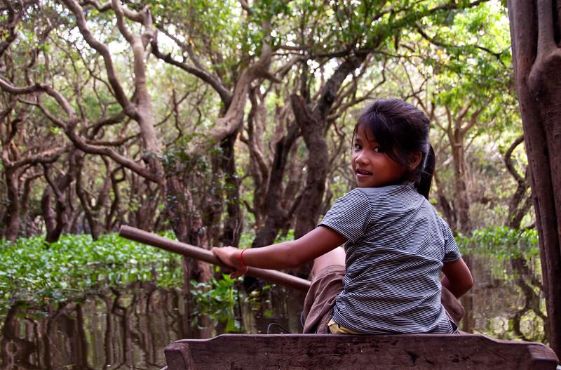 Mangrove forest navigator, Kompong Phluk floating village, Tonle Sap, Cambodia