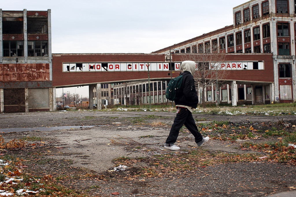 . DETROIT - NOVEMBER 19:  a person walks past the remains of the Packard Motor Car Company, which ceased production in the late 1950`s, November 19, 2008 in Detroit, Michigan. The Big Three U.S. automakers, General Motors, Ford and Chrysler, are appearing this week in Washington to ask for federal funds to curb to decline of the American auto industry. Detroit, home to the big three, would be hardest hit if the government lets the auto makers fall into bankruptcy.  (Photo by Spencer Platt/Getty Images)