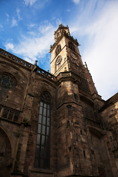 Church Tower of Bolzano Cathedral.  The swirling clouds and morning sunlight made for a fantastic morning.