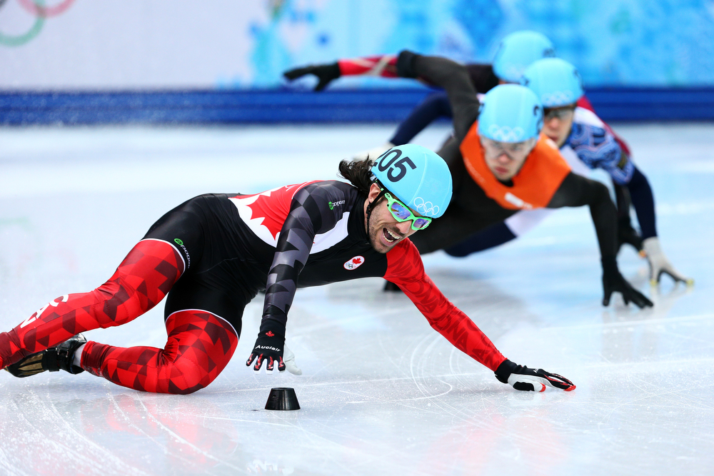 . Charles Hamelin of Canada falls while competing in the Short Track Men\'s 500m Heat at Iceberg Skating Palace on day 11 of the 2014 Sochi Winter Olympics on February 18, 2014 in Sochi, Russia.  (Photo by Paul Gilham/Getty Images)