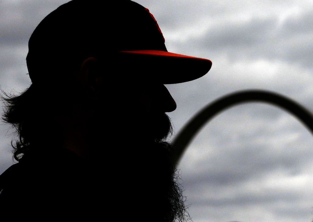 . San Francisco Giants injured relief pitcher Brian Wilson talks to a reporter before Game 4 of baseball\'s National League championship series against the St. Louis Cardinals Thursday, Oct. 18, 2012, in St. Louis. (AP Photo/David J. Phillip)