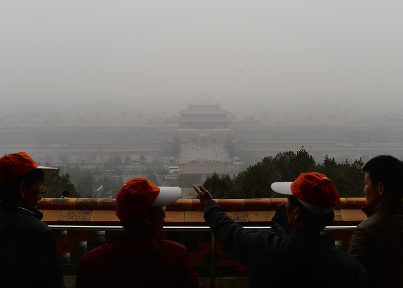 . Tourists look out over the Forbidden City from Jingshan Hill as heavy air pollution continues to shroud Beijing on February 26, 2014. Beijing\'s official reading for PM 2.5, small airborne particles which easily penetrate the lungs and have been linked to hundreds of thousands of premature deaths, stood at 501 micrograms per cubic metre.  (MARK RALSTON/AFP/Getty Images)