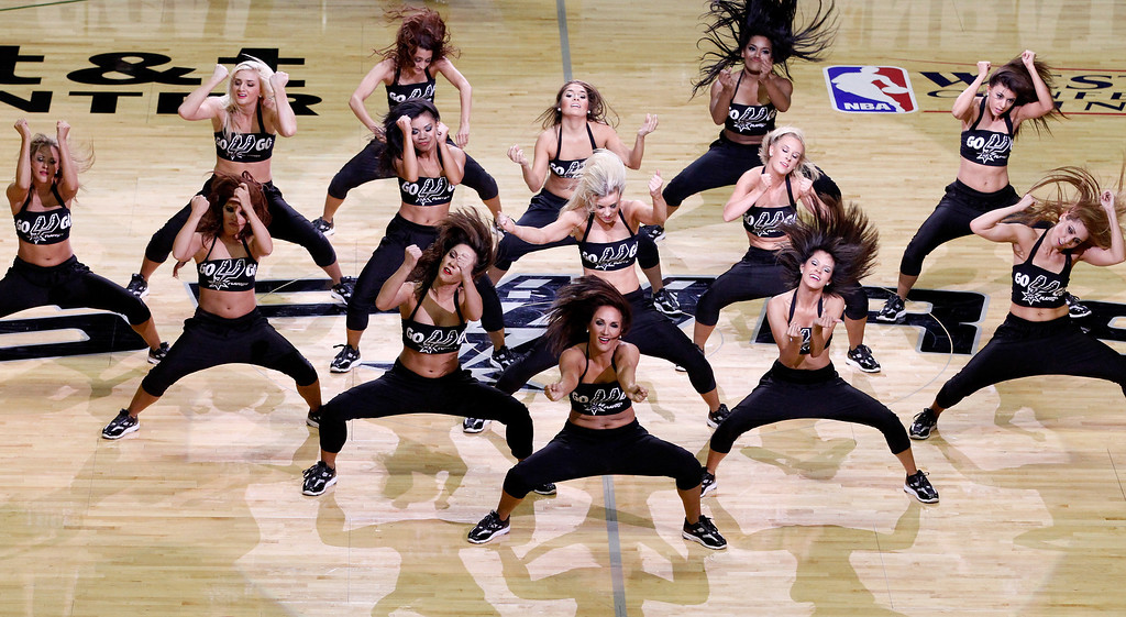 . San Antonio Spurs cheerleaders perform in Game One of the Western Conference Finals during the 2014 NBA Playoffs at AT&T Center on May 19, 2014 in San Antonio, Texas.  (Photo by Chris Covatta/Getty Images)