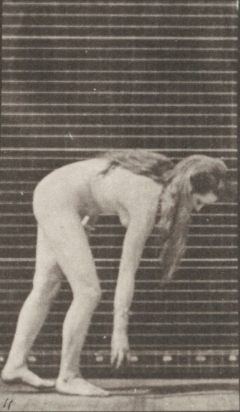 Nude woman stooping to pick up a ball