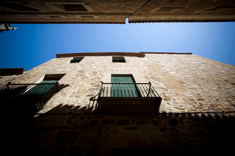 Low angle view of a narrow street, Caceres, Spain