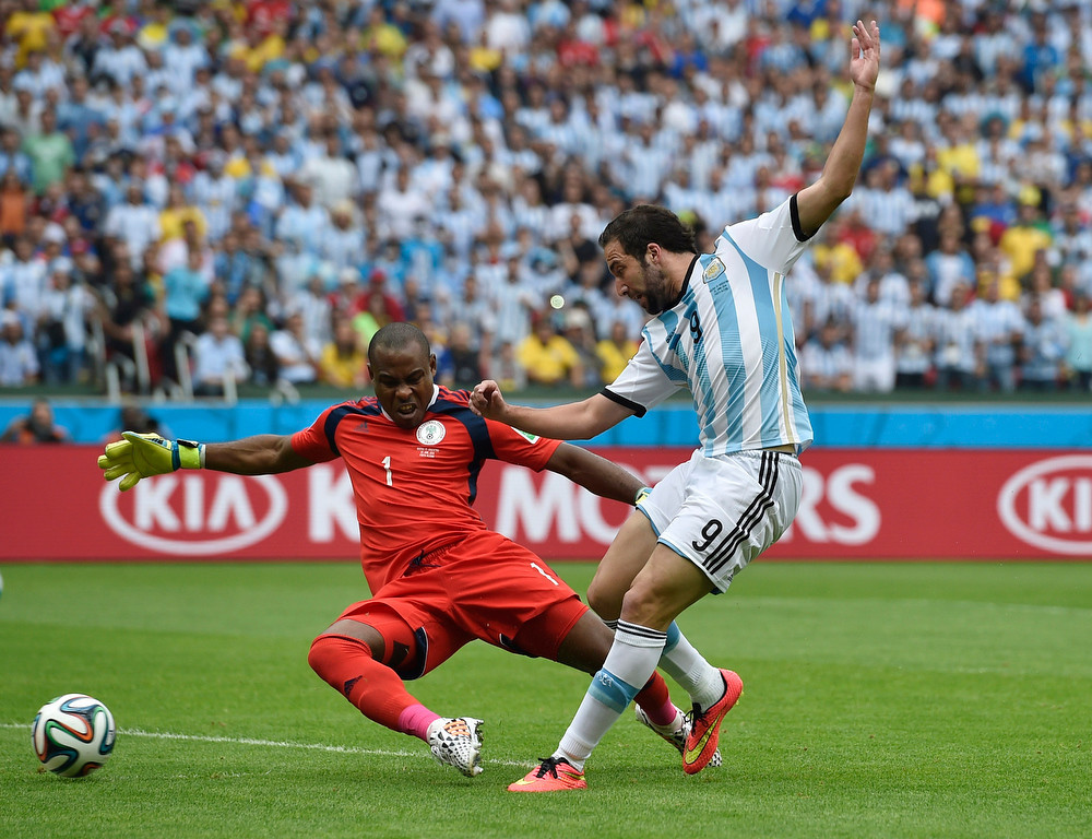 . Nigeria\'s goalkeeper Vincent Enyeama comes in to defend against Argentina\'s Gonzalo Higuain during their group F World Cup soccer match at the Estadio Beira-Rio in Porto Alegre, Brazil, Wednesday, June 25, 2014. (AP Photo/Martin Meissner)