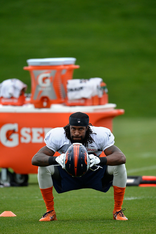 . Denver Broncos strong safety David Bruton (30) warms up before the start of day 12 of the Denver Broncos 2014 training camp August 5, 2014 at Dove Valley. (Photo by John Leyba/The Denver Post)