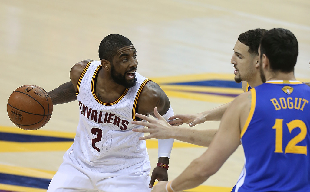 . Cleveland Cavaliers guard Kyrie Irving (2) is double teamed by Golden State Warriors\' Klay Thompson and Andrew Bogut (12) during the first half of Game 4 of basketball\'s NBA Finals in Cleveland, Friday, June 10, 2016. (AP Photo/Ron Schwane)