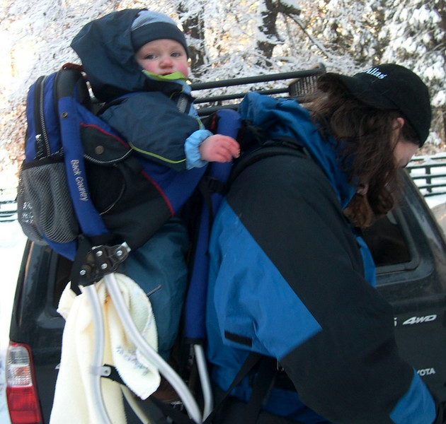 Peter snowshoeing with Kelly in backpack CA USA