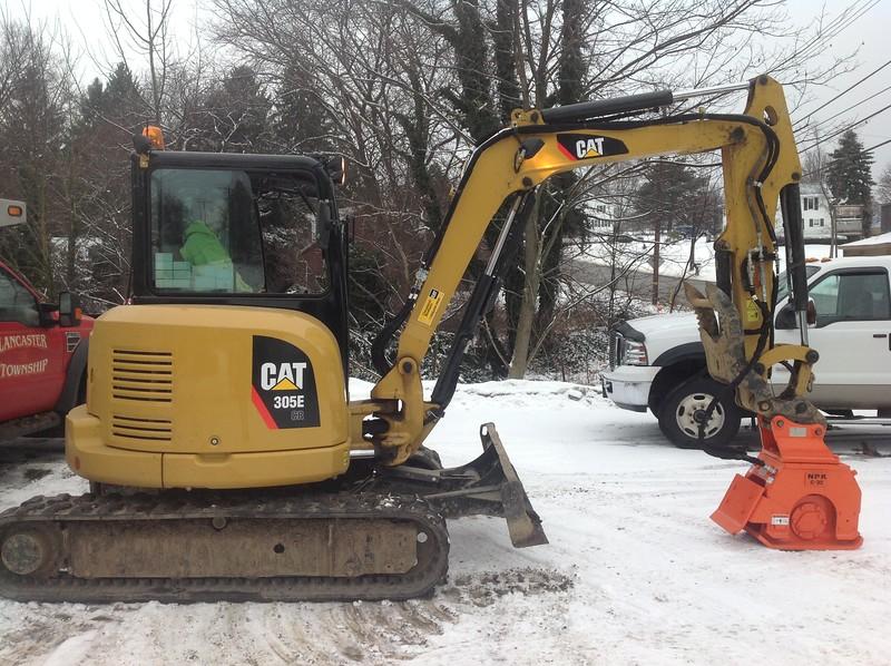 NPK C3D compactor with backfill blade on Cat mini excavator (3).JPG