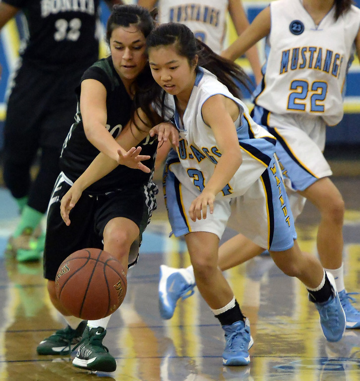 . Bonita\'s Cassie Martinez, left, scrambles for the loose ball with Walnut\'s Jenna Pitpit (34) in the first half of a prep basketball game at Walnut High School in Walnut, Calif., on Wednesday, Jan. 15, 2014. Bonita won 60-50. (Keith Birmingham Pasadena Star-News)
