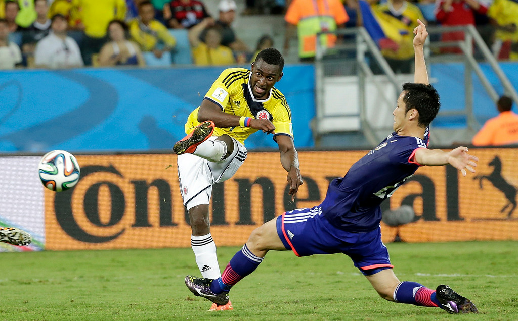 . Colombia\'s Jackson Martinez scores his team\'s third goal during the group C World Cup soccer match between Japan and Colombia at the Arena Pantanal in Cuiaba, Brazil, Tuesday, June 24, 2014. (AP Photo/Felipe Dana)