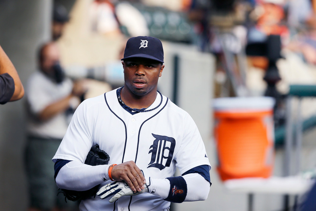 . Detroit Tigers center fielder Rajai Davis is seen in the dugout before the first inning of an interleague baseball game against the Colorado Rockies, Friday, Aug. 1, 2014, in Detroit. (AP Photo/Carlos Osorio)