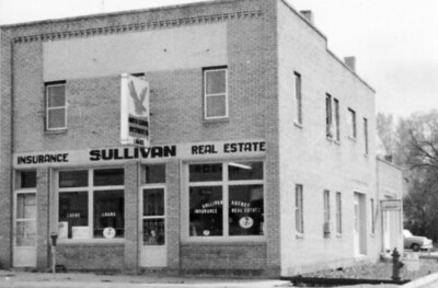Thanks to John Sullivan of Spearfish for sharing this photograph of the Sullivan Building that once housed the Spearfish Public Library (entrance was on the west side of the building -- on the right above).  John's father ran an insurance and real estate business from this location -- 5th and Hudson Street.  The building sat where the Wells Fargo Bank Drive-Through is now located.  The Sullivan family lived upstairs.