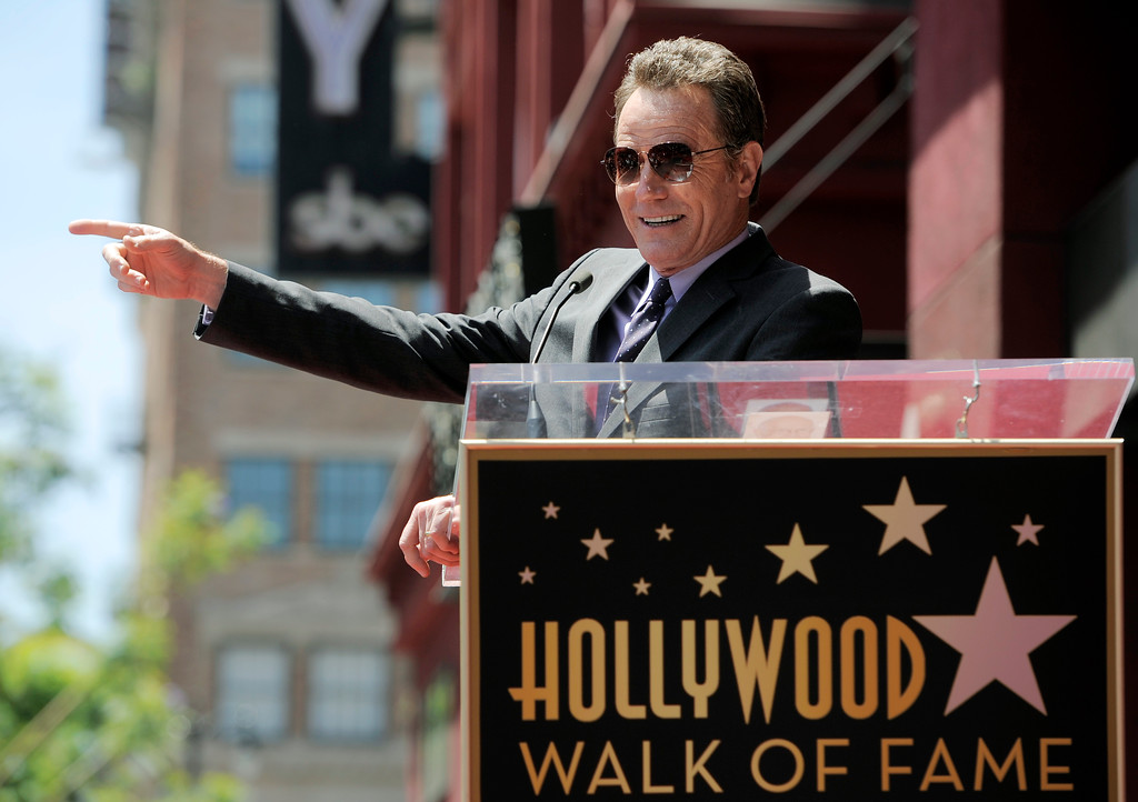 """. Bryan Cranston, star of the television series \""""Breaking Bad,\"""" addresses the crowd before receiving a star on the Hollywood Walk of Fame on Tuesday, July 16, 2013 in Los Angeles. (Photo by Chris Pizzello/Invision/AP)"""