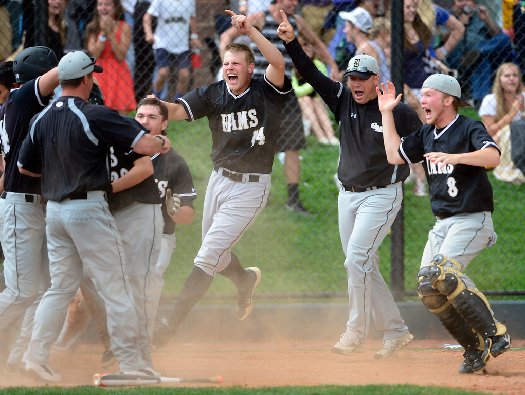 . LAKEWOOD, CO - MAY 23: Green Mountain celebrates its win against Durango. The Durango Demons take on the Green Mountain Rams in the 4A Baseball State Semi-Final Championships. (Kathryn Scott Osler, The Denver Post)