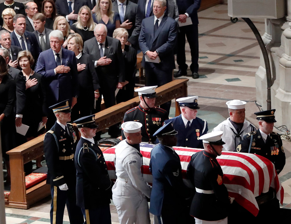 . From front row left, former first lady Laura Bush, former President Bill Clinton, former Secretary of State Hillary Clinton, former Vice President Dick Cheney and his wife Lynne and former Vice President Al Gore watch a the casket arrives for a memorial service for Sen. John McCain, R-Ariz., at Washington National Cathedral in Washington, Saturday, Sept. 1, 2018. McCain died Aug. 25, from brain cancer at age 81. (AP Photo/Pablo Martinez Monsivais)