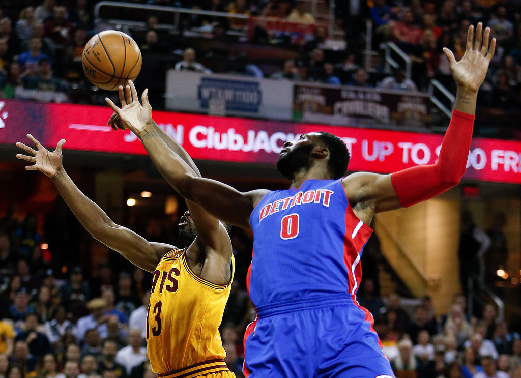 . Detroit Pistons\' Andre Drummond (0) and Cleveland Cavaliers\' Tristan Thompson (13) reach for a rebound during the first half of an NBA basketball game Friday, Nov. 18, 2016, in Cleveland. (AP Photo/Ron Schwane)
