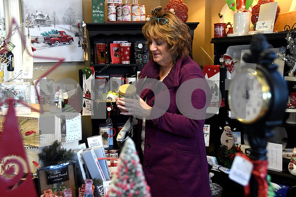 11/25/2017 Mike Orazzi   Staff Jane Snow of Bristol while shopping at Good Cause Gifts on Main Street in Berlin Saturday.