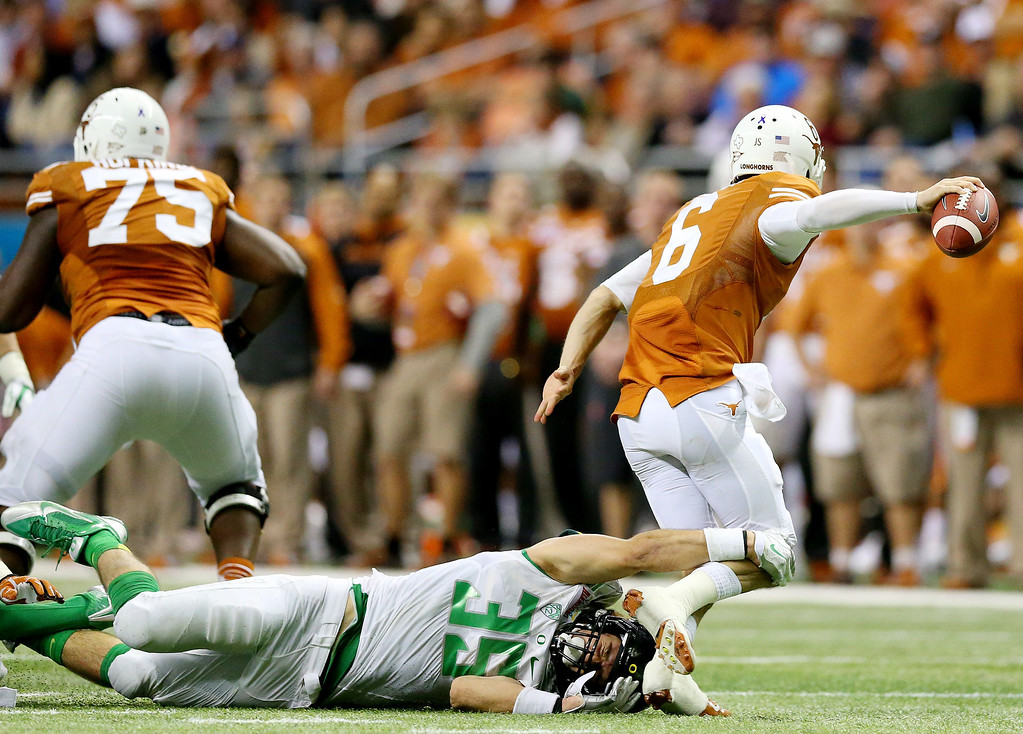 . Linebacker Joe Walker #35 of the Oregon Ducks sacks quarterback Case McCoy #6 of the Texas Longhorns during the Valero Alamo Bowl at the Alamodome on December 30, 2013 in San Antonio, Texas.  (Photo by Ronald Martinez/Getty Images)