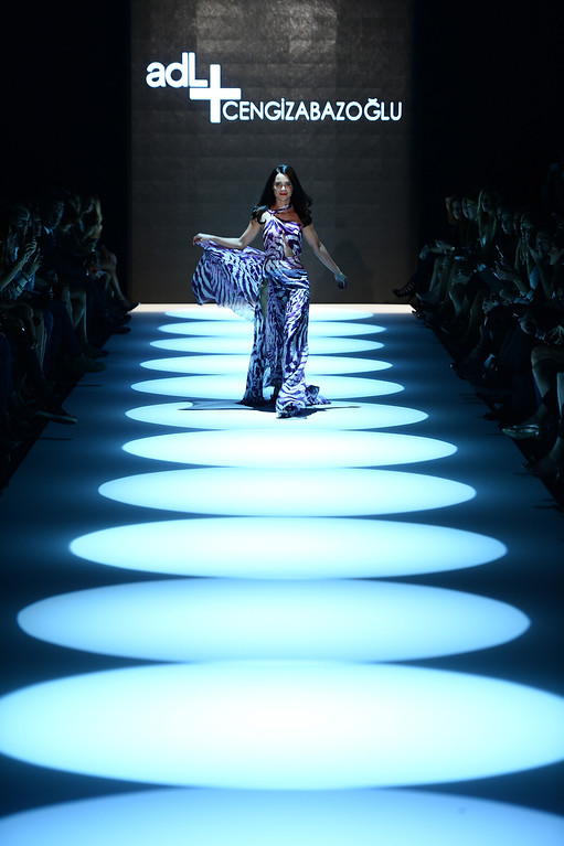 . A model walks the runway at the ADL & Cengiz Abazoglu show during Mercedes-Benz Fashion Week Istanbul s/s 2014 presented by American Express on October 8, 2013 in Istanbul, Turkey.  (Photo by Ian Gavan/Getty Images for IMG)