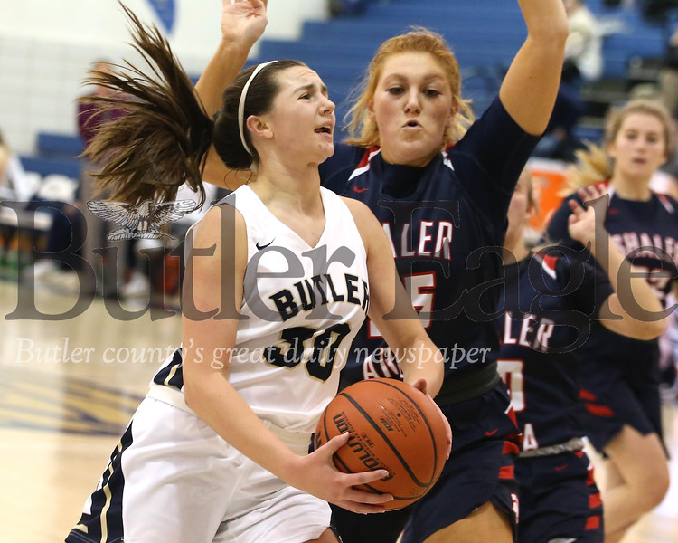 Butler sophomore forward Makenna Maier (30) drives past Shaler's Claire Grunden (25) to attempt a layup in Butler's 49-42  home win Monday night. Seb Foltz/Butler Eagle