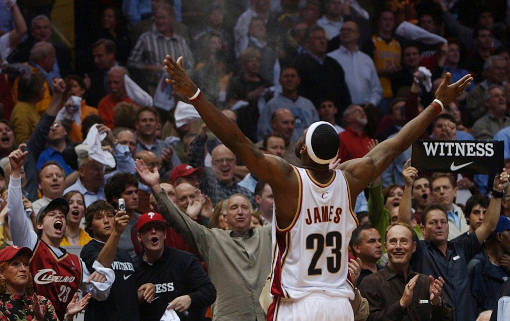. MORNING JOURNAL/DAVID RICHARD LeBron James plays to the crowd at Quicken Loans Arena before Game 4 of the Eastern Conference Playoffs May 15, 2006 against Detroit. The Cavaliers won the game to tie the series at two wins apiece.